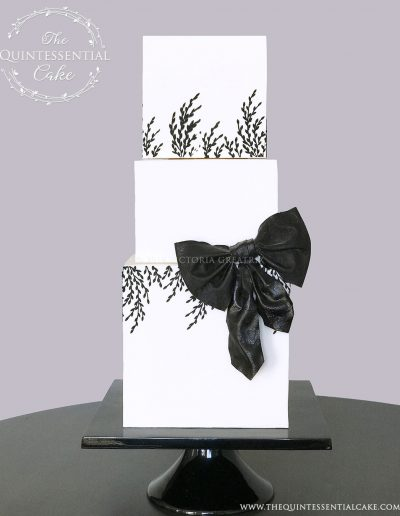 TQC Square Wedding Cake with Black Bow | The Quintessential Cake | Luxury Wedding Cakes | Chicago | Hotel Baker | St Charles | The Celebration Society Magazine